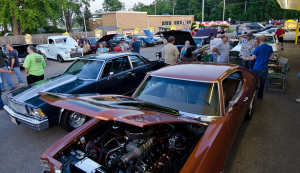Classic cars parked at Miller's Dog 'n Suds cruise night in Foxlake, Illinois.