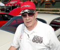 David Dehart stands next to his 1964 Dodge Custom 880.