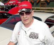 David Dehart stands next to his 1964 Dodge Custom 880.