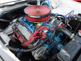 A 361ci V8 is in underhood.