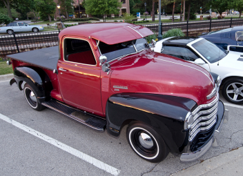 Classic cars parked in downtown Roselle, Illinois at the cruise night.