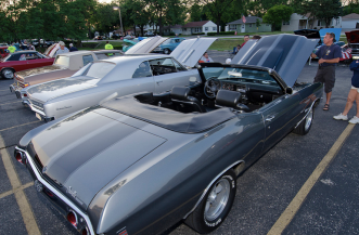 Classic cars parked in Rolling Meadows at the cruise night.