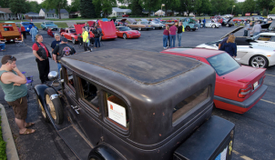 Classic cars parked at the Rolling Meadows cruise night.