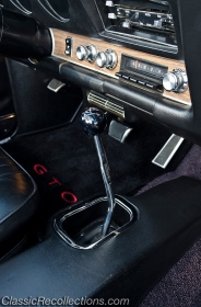 This 1969 Pontiac GTO convertible is eqiupped with a four-speed transmission.