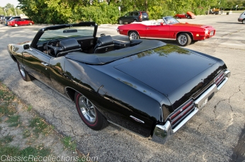 This 1969 Pontiac GTO convertible has a 400ci V8 and a four speed manual transmission.
