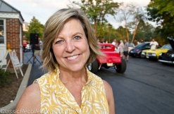 Anne Garrett helps to oversee the downtown Barrington, Illinois classic car cruise night.