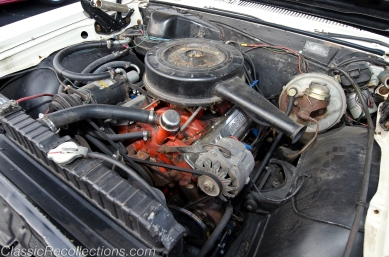 Under the hood of this 1965 Chevrolet El Camino is the factory 327ci V8.