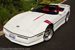 This white 1989 Chevrolet Corvette has been modified.