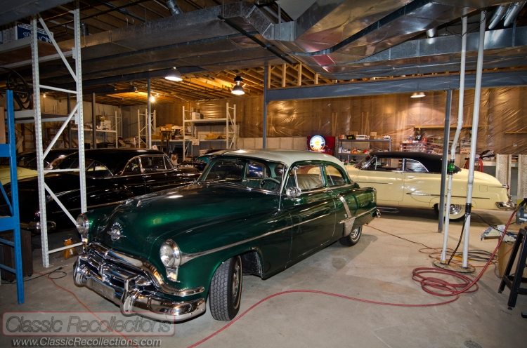 These classic Oldsmobile cars are stored in a dream garage - in a basement!