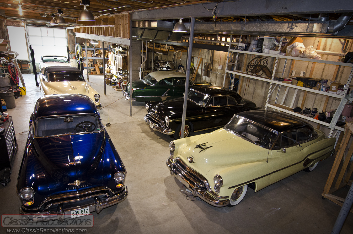 classic oldsmobile cars are stored in a dream garage in a basement