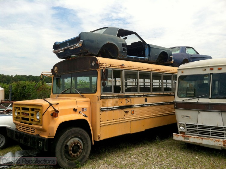 These classic Ford Mustangs were parked on top of a bus.