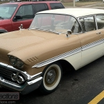 This 1958 Chevrolet Biscaynee was driving in the rain.